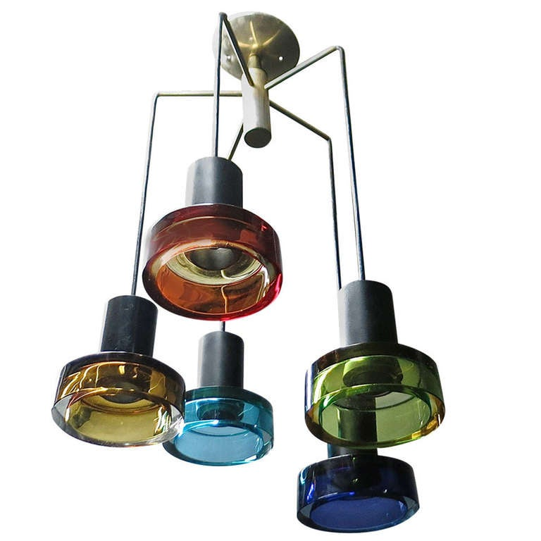 Ceiling fixture with five thick, colored glass lights. Each glass cylinder has a single standard socket and measures 6.25 inches in diameter.    Final drop is adjustable.
