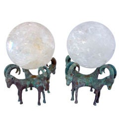 Pair of Rock Crystal Globes Supported by Bronze Rams