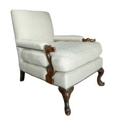 A Fine Club Chair with Carved Arms and Feet