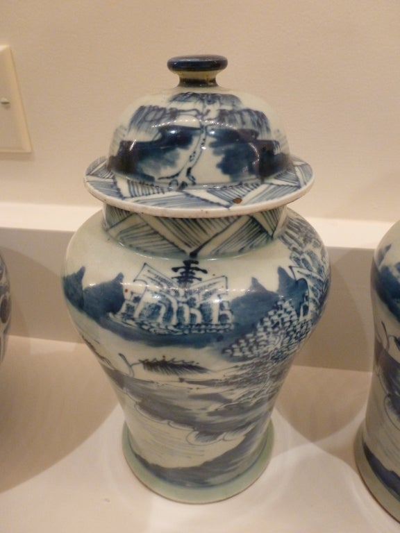 Chinese Export Pair of Blue and White Ceramic Lidded Vases For Sale