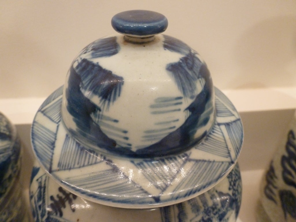Chinese Pair of Blue and White Ceramic Lidded Vases For Sale