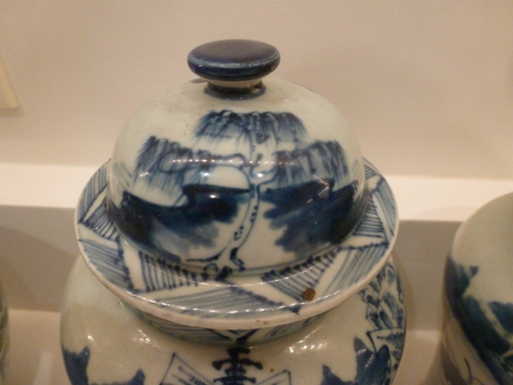 Hand-Painted Pair of Blue and White Ceramic Lidded Vases For Sale