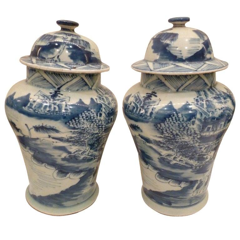 Pair of Blue and White Ceramic Lidded Vases For Sale
