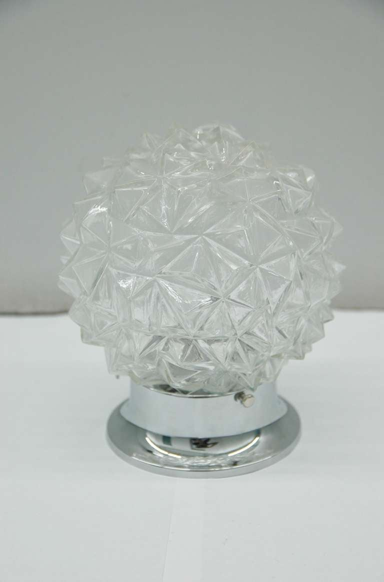 Set of two-light fixtures of molded glass globes to resemble faceted diamonds. Rewired.