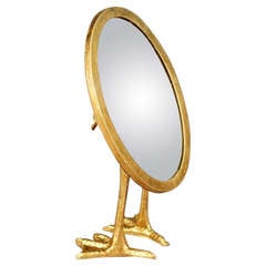 A Gilt Metal Table Mirror with Bird's Feet in the manner of Meret Oppenheim