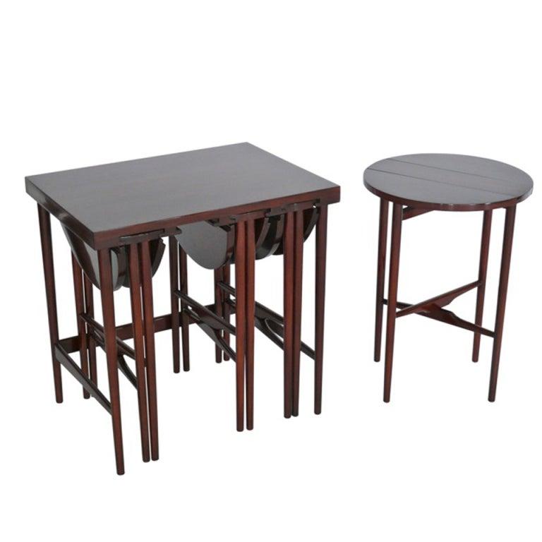 Walnut nesting tables by bertha schaeffer for singer and