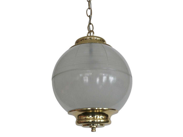 Azucena milky glass globe pendant with shiny brass hardware. Globe hangs beautifully on a brass chain. Newly rewired. Simply Gorgeous! Three available.