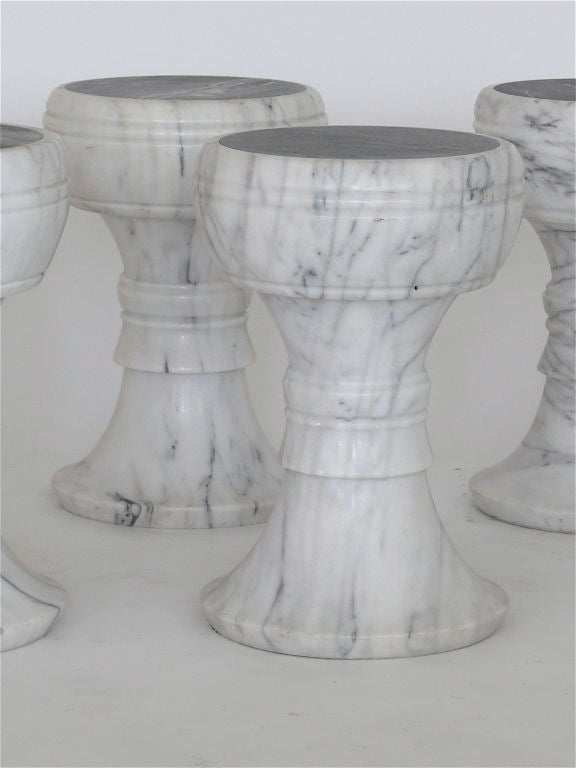 """Beautiful solid Carrera marble garden stool.  Each seat has solid black marble inlaid tops and is carved from a solid piece of marble.  Carrera marble has beautiful grey swirling creating each """"chess-like"""" stool to be slightly different from one"""