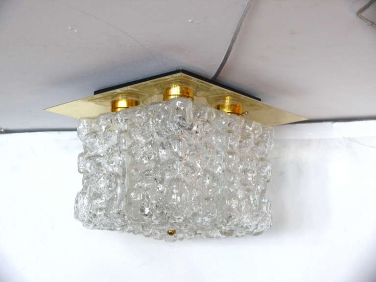 Gorgeous, small scale Flush Mount by Hillebrand. Four Rectangular pieces of Ice Glass extended from floating brass frame. Excellent vintage condition. Newly rewired.