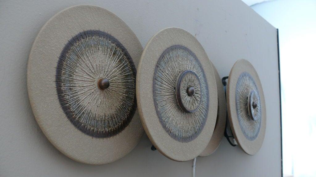 Large etched ceramic disc sconces at stdibs