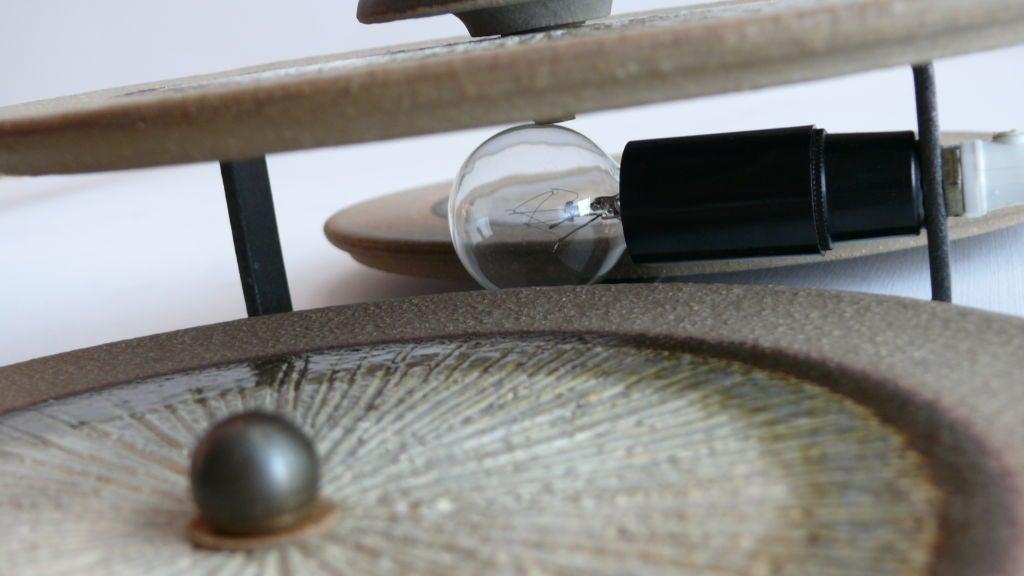 Etched ceramic disc sconces at stdibs