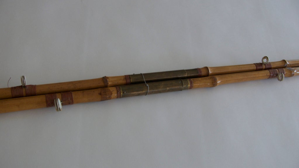 Pair of vintage bamboo fishing poles at stdibs