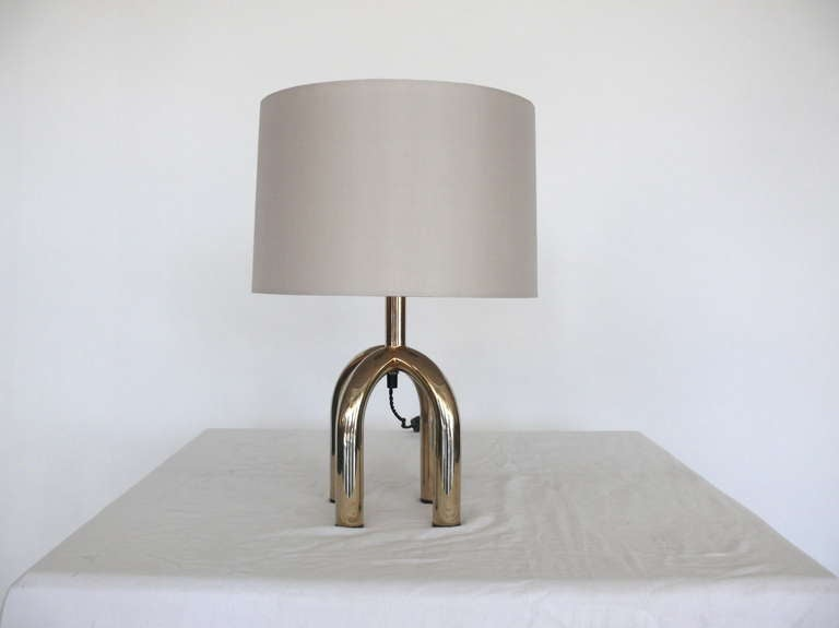 Amazing pair of Italian nickel and brass table lamps. Lamps rest on arched four prong base with exposed cord. Newly rewired and new shades. Nice small scale.