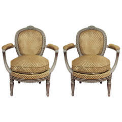 Pair of Beaux Arts Painted oval back armchairs