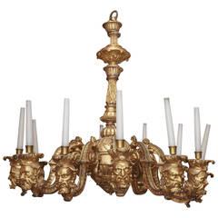 French Regence Style Carved Giltwood Twelve-Light Chandelier