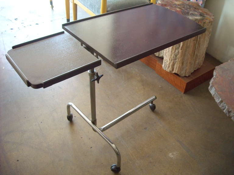 Many functions in this very versatile bar/trolley/ cart with a tilt top for reading and a horizontal side for glasses or drinks.The high can be adjustable in many positions.