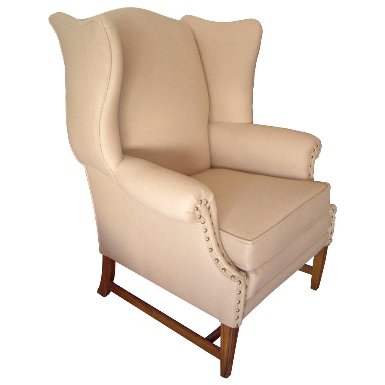 Early Wingback Chair with Studded Brass Arm Holders Front