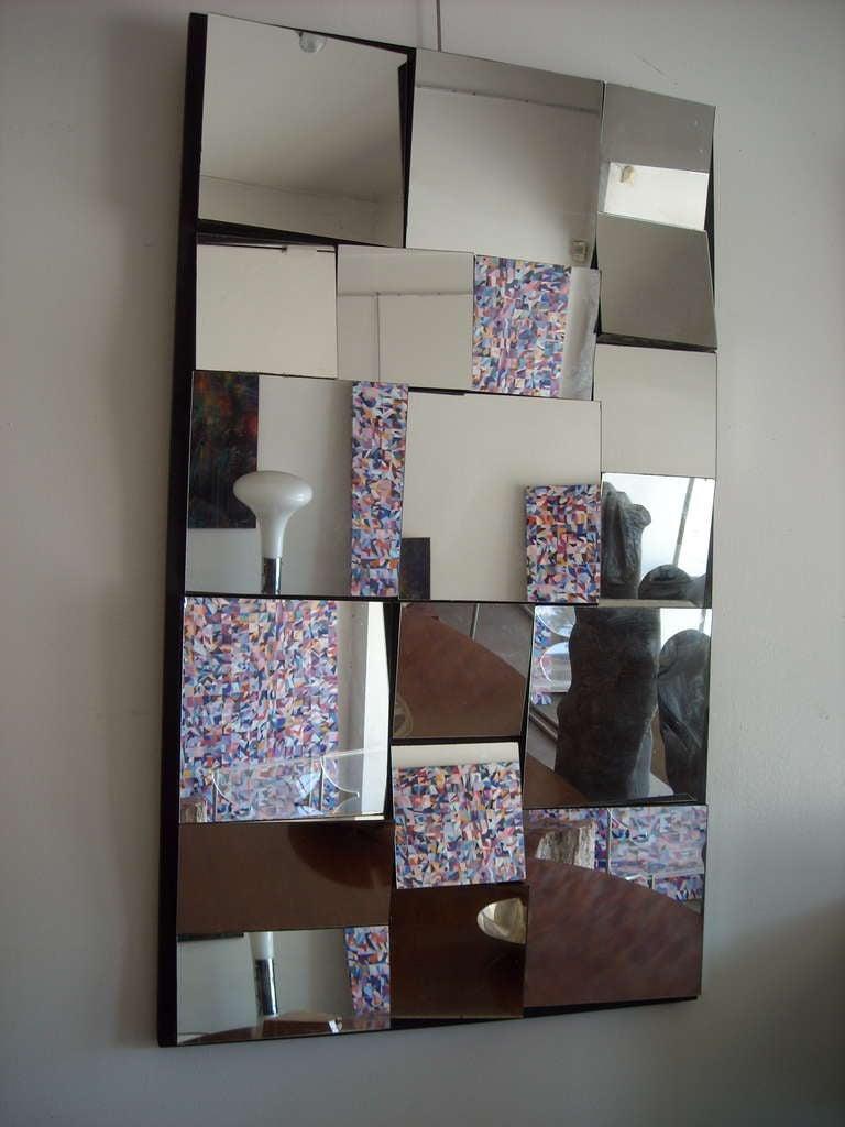 This is a vintage mirror created in the same style than Neal Small.This mirror can go horizontal or vertical as it shows in the pictures.