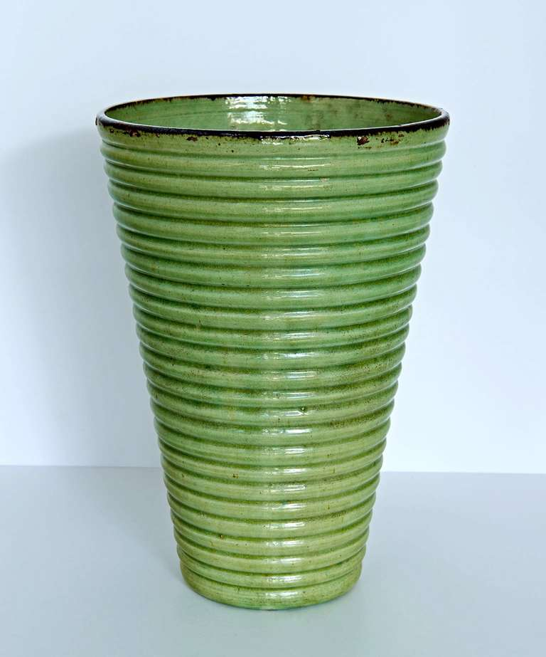 From Dieulefit, in Haute Provence, this nearly ten-inch vase has good proportions and a vibrant glaze.