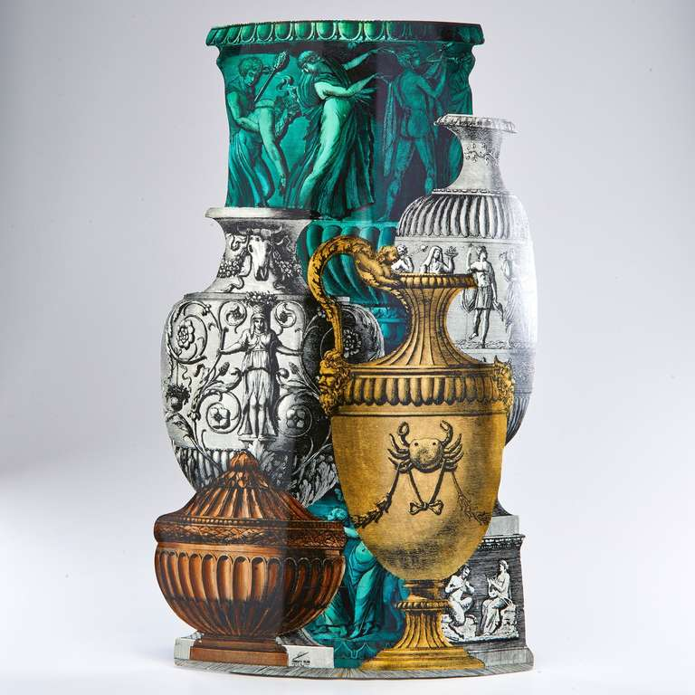 A trompe l'oeil group of classical vases decorates the outer surface of a chic and practical umbrella stand. Designed by Fornasetti in the early 1950s, this example was made more recently. Fully marked.