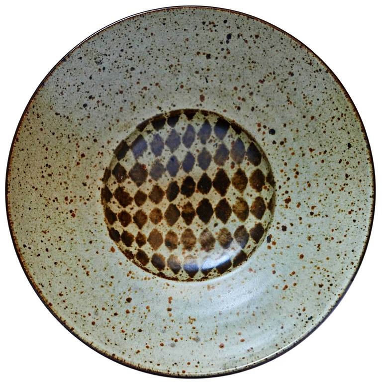 California studio potter and influential teacher Antonio Prieto threw this stoneware bowl with a two-stage profile, and then decorated the interior with lozenge forms, comprising a rather informal-looking harlequin pattern. Signed