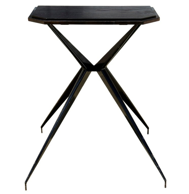 This French console table is an elaborate and expressive steel structure exquisitely made from folded and welded steel, mostly of triangular section. Which invites a comparison with the