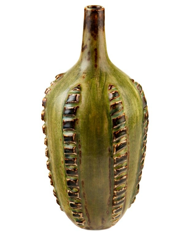 This gorgeous vase by Axel Salto has the most organic glaze I have ever seen on any ceramic object. It is as if the surface is saturated with chlorophyl. Resembling a large, imaginary tropical fruit, the ribbed form is a cousin of Salto's famous