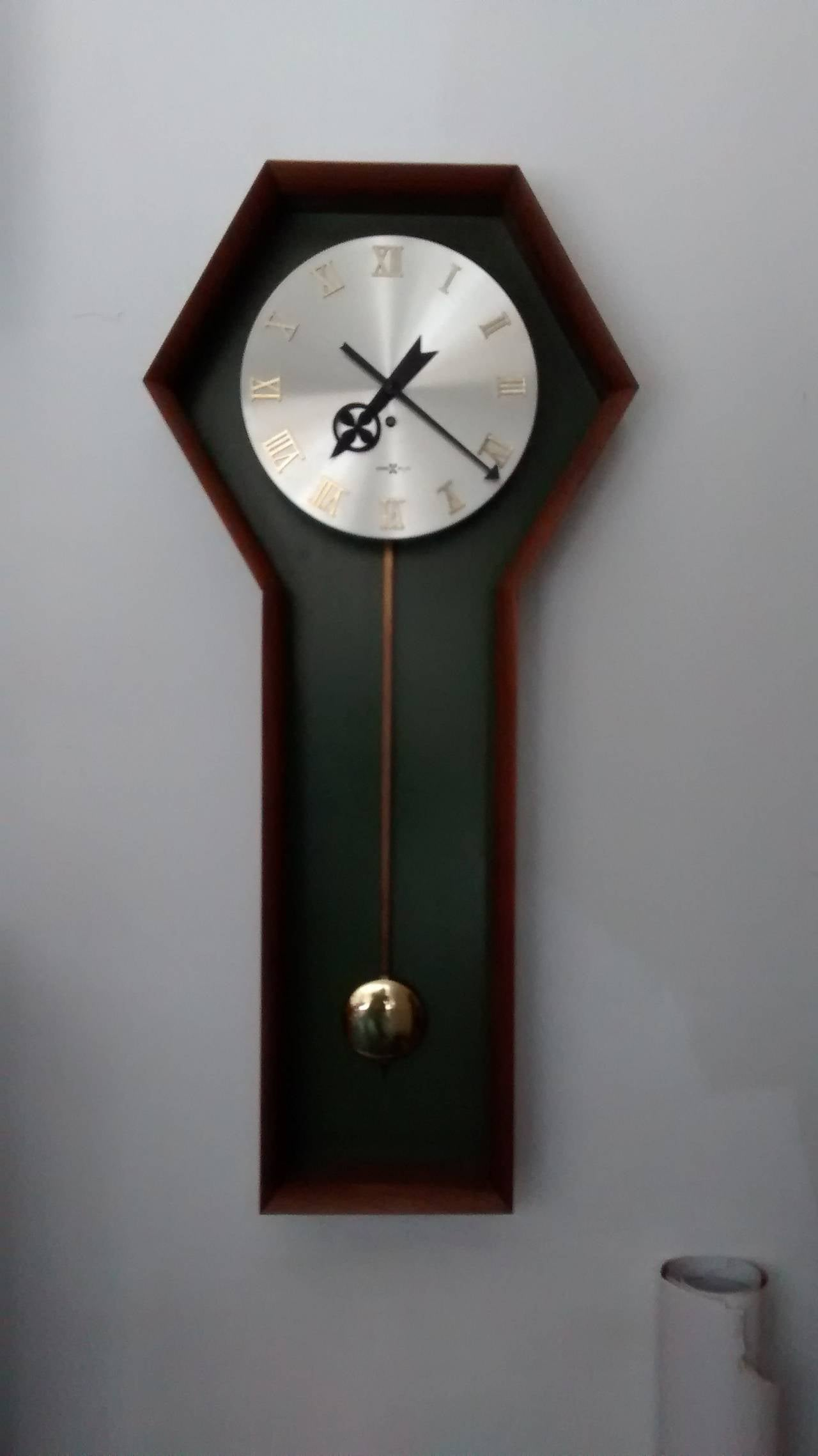 Wall mounted pendulum clock by george nelson for howard for Nelson wall clock