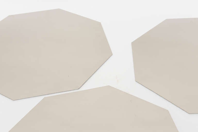 These octagonal signed Italian vintage Romeo Rega stainless steel placemats and or charger plates make a great statement to any dining table. They have a high mirrored polish and new white felt on the bottom. They are rare, hard to find and simply