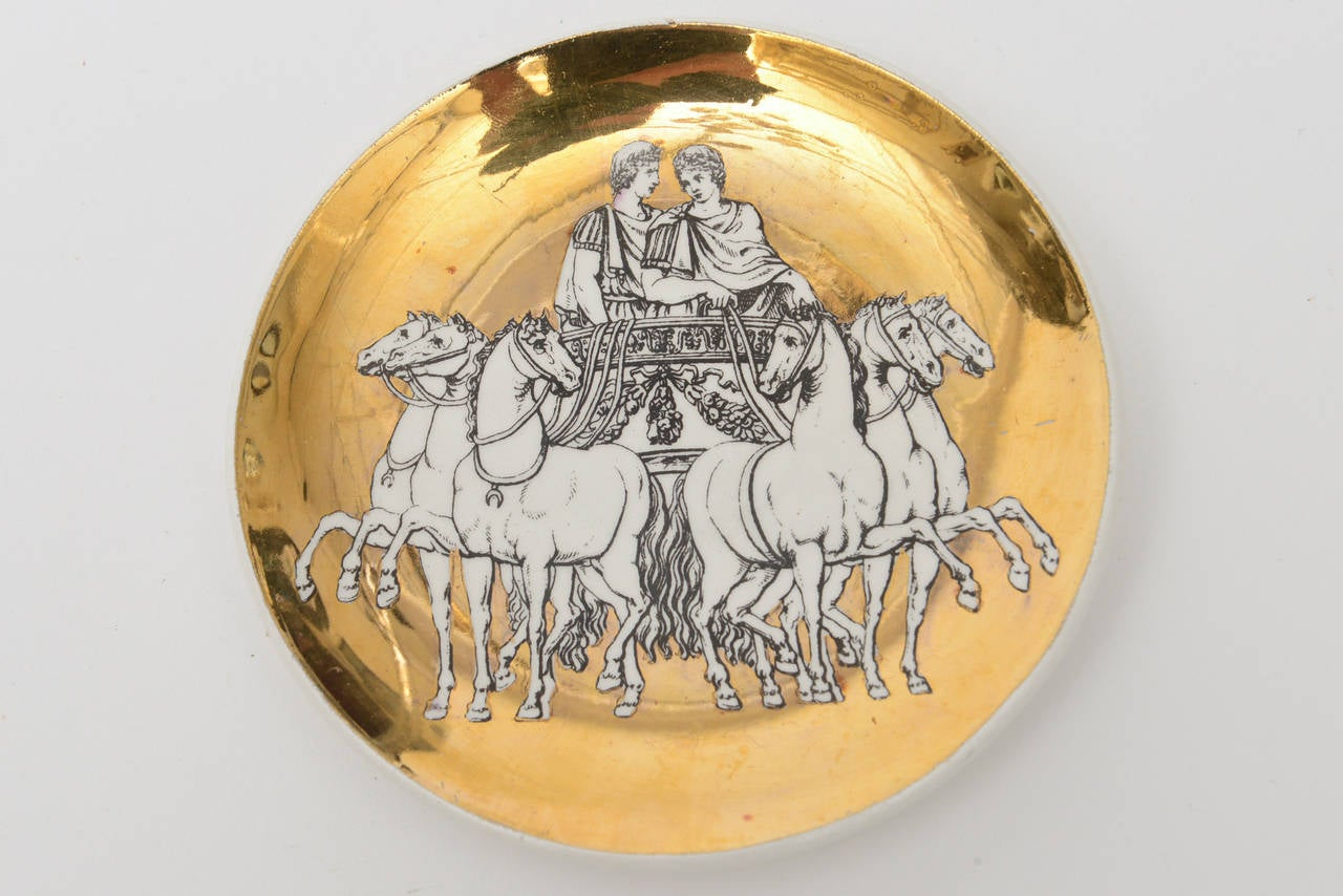 Classical Roman Set of Eight Italian Fornasetti Gilded Porcelain Roman Chariot Coasters For Sale