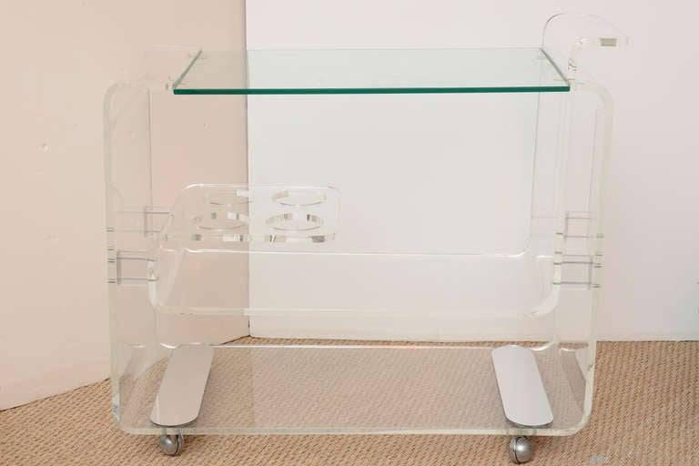 Thick  rolled curved lucite with mirorred original rectangle bottoms and original  chrome ball feet The lucite compartment for wine bottles adds a nice touch!  Very well lmade and sturdy!!! CHIC!!!  GET READY FOR SUMMER!!!  NOTE: THIS WILL BE