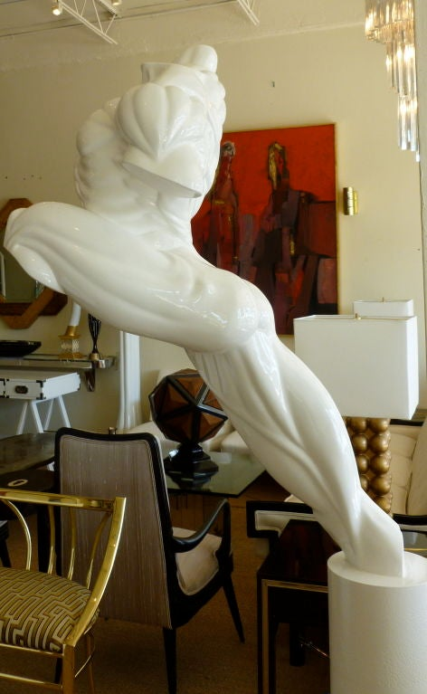 This is a Wow! Move over Michaelangelo's David. This leaping lacquered resin male torso life size stands over 6'ft tall with all of it's musculature from every angle sits atop a round iron pedestal that also has been lacquered white. it leaps,