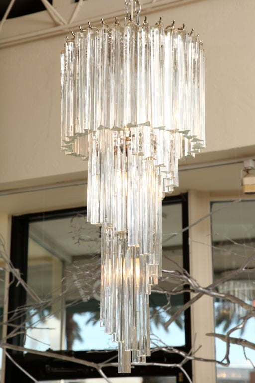 The play of tiers with this Italian Murano crystal prisms play fantastically with light. The glass hanging prisms are tri-pointed.  The gracious