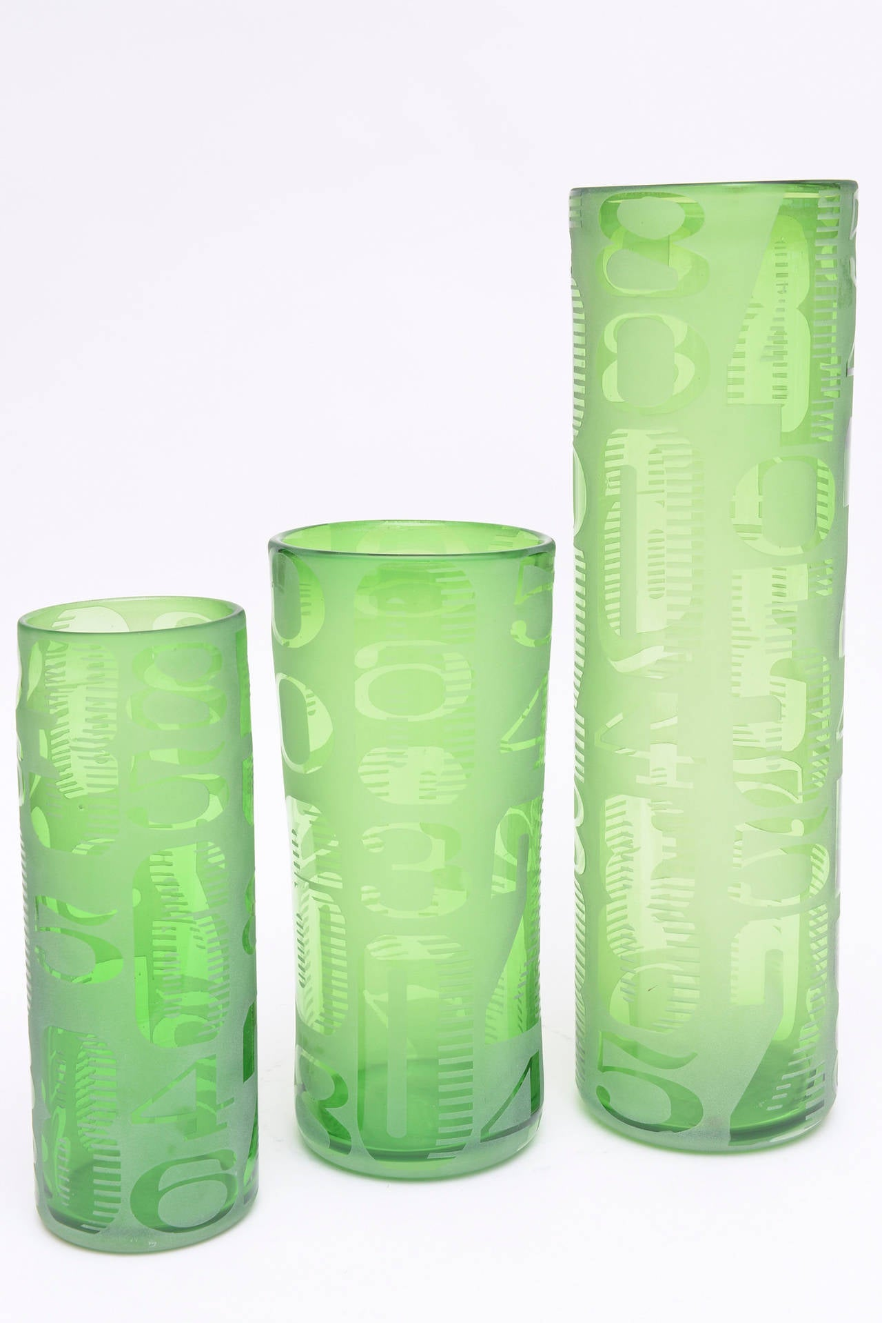Trio of three graduated frosted and etched numbered glass vases the numbers abound in small and large format and are all etched reviewsmspy