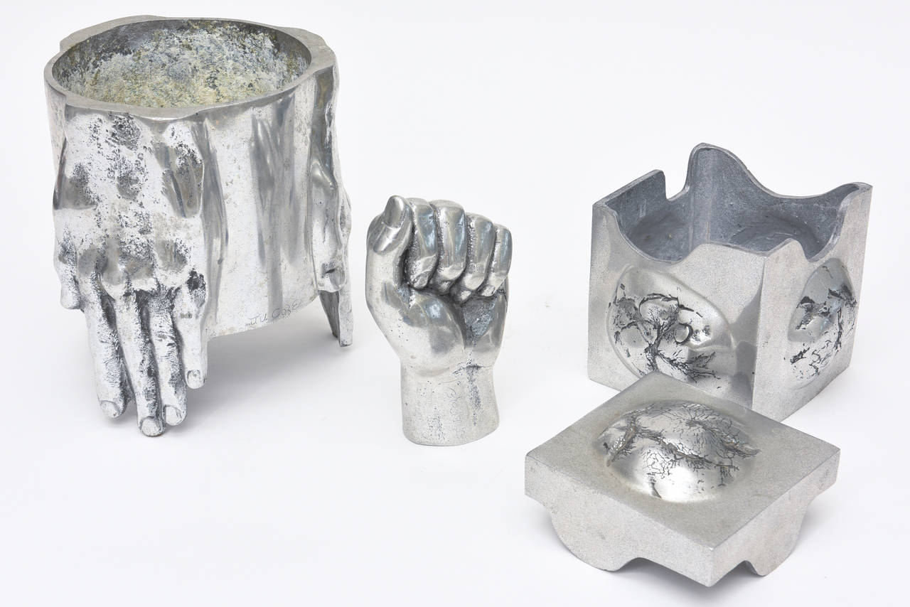 These set of three objects, sculpture are in the style of Richard Etts. There is a vessel, vase and small planter, a two-part box and a fist hand sculpture. The planter can house a beautiful orchid or flowers. These must be sold as a set! The size