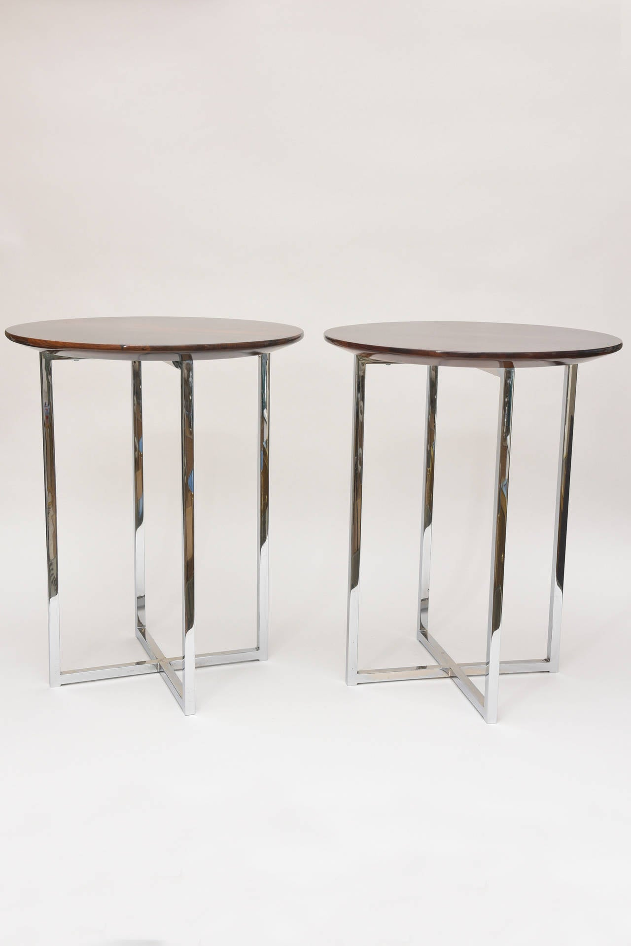 These sculptural versatile, stunning and timeless side tables of Milo Baughman have the most beautiful exotic wood tops. The wood is unknown, but I believe of Italian origin. They have a high polish on top. The chrome bases have all been polished.
