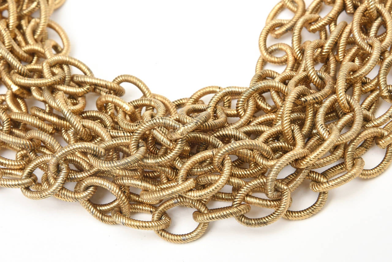 This heavy and dramatic Italian chain necklace makes a statement. It is textured and signed on the clasp by Graziani. It has a rich look to it!! It certainly falls on the neck beautifully! It does have some weight to it... you will definitely feel