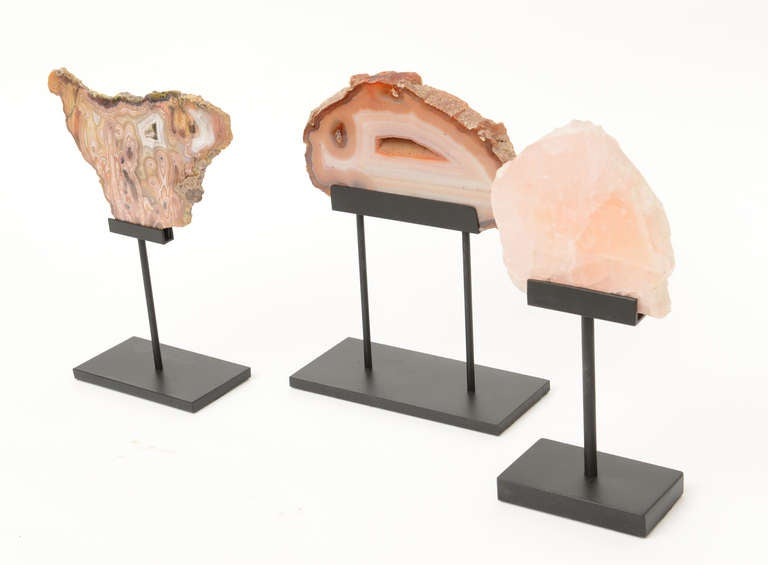 These are three vintage beautiful rose quartz and agate polished stones sculptures on metal custom bases. They have their with original labels of handwriting on old yellowed paper on the back of the stones. They are from the 1950s. The stones are