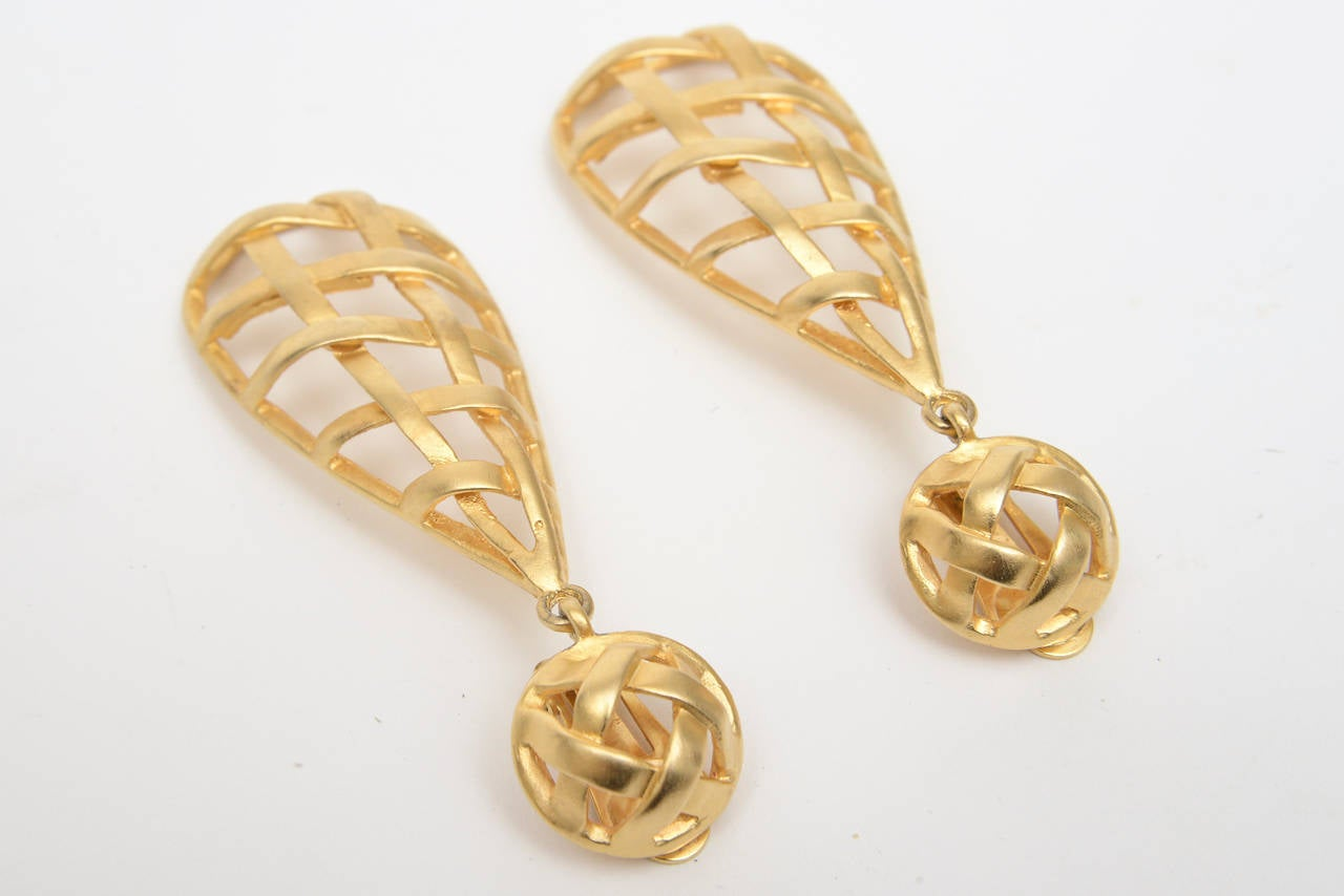 Modern Pair of Gold Plated Criss Cross Cage Dangle Earrings For Sale