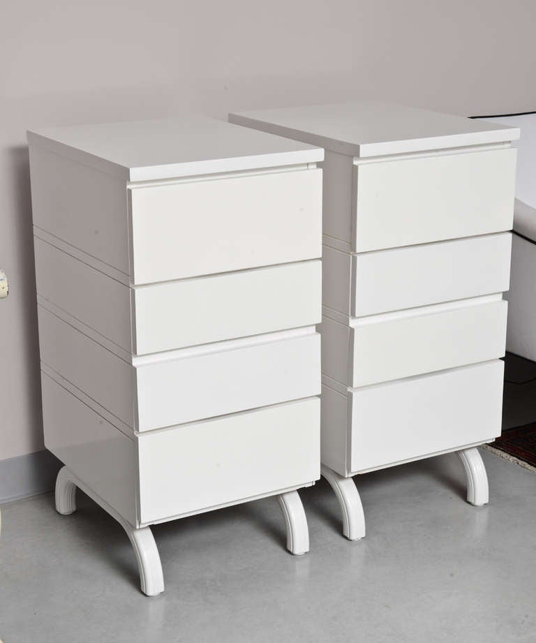 White piano finish lacquer.These dressers have a stunning shape both have jewelry drawers also