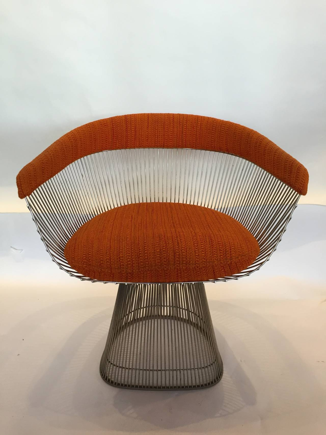 A single nickel framed side chair in original orange wool fabric (great original condition). Designed by Warren Platner for Knoll.