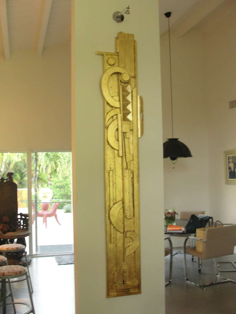 Gold leaf over wood totem wall sculpture in the style of Louise Nevelson. This is one of two. (Other is Silver leaf). Louise Nevelson (September 23, 1899–April 17, 1988) was an American sculptor known for her monumental, monochromatic, wooden wall