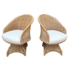 Curvaceous Pair of Vintage Wicker Swivel Chairs