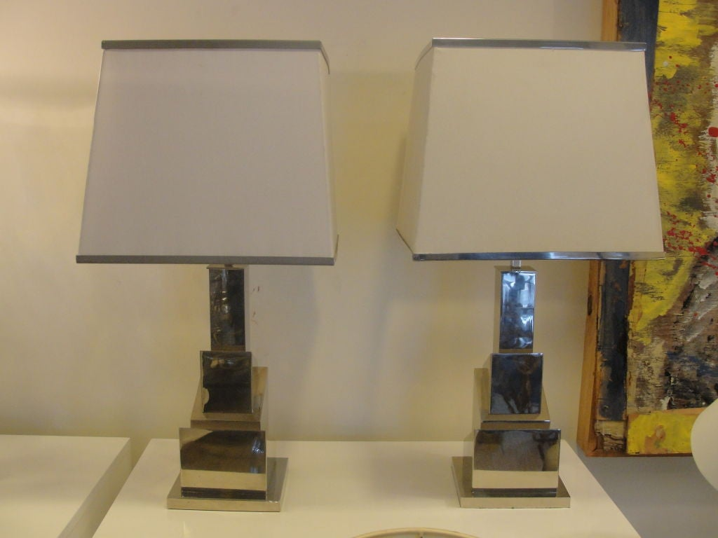Exceptional design, these skyscraper table lamps with a deco flair and very streamlined. Shades have metal trim, all original and each is stamp signed at base. Two sockets per lamp and rewired white silk cable.