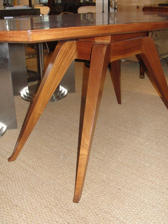 Exceptional shape and sculptural legs. This table will make a statement in any home or a beautiful showroom.