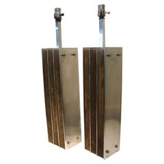 A Stunning Pair of Laurel Lamps in Polished Aluminum & Suede