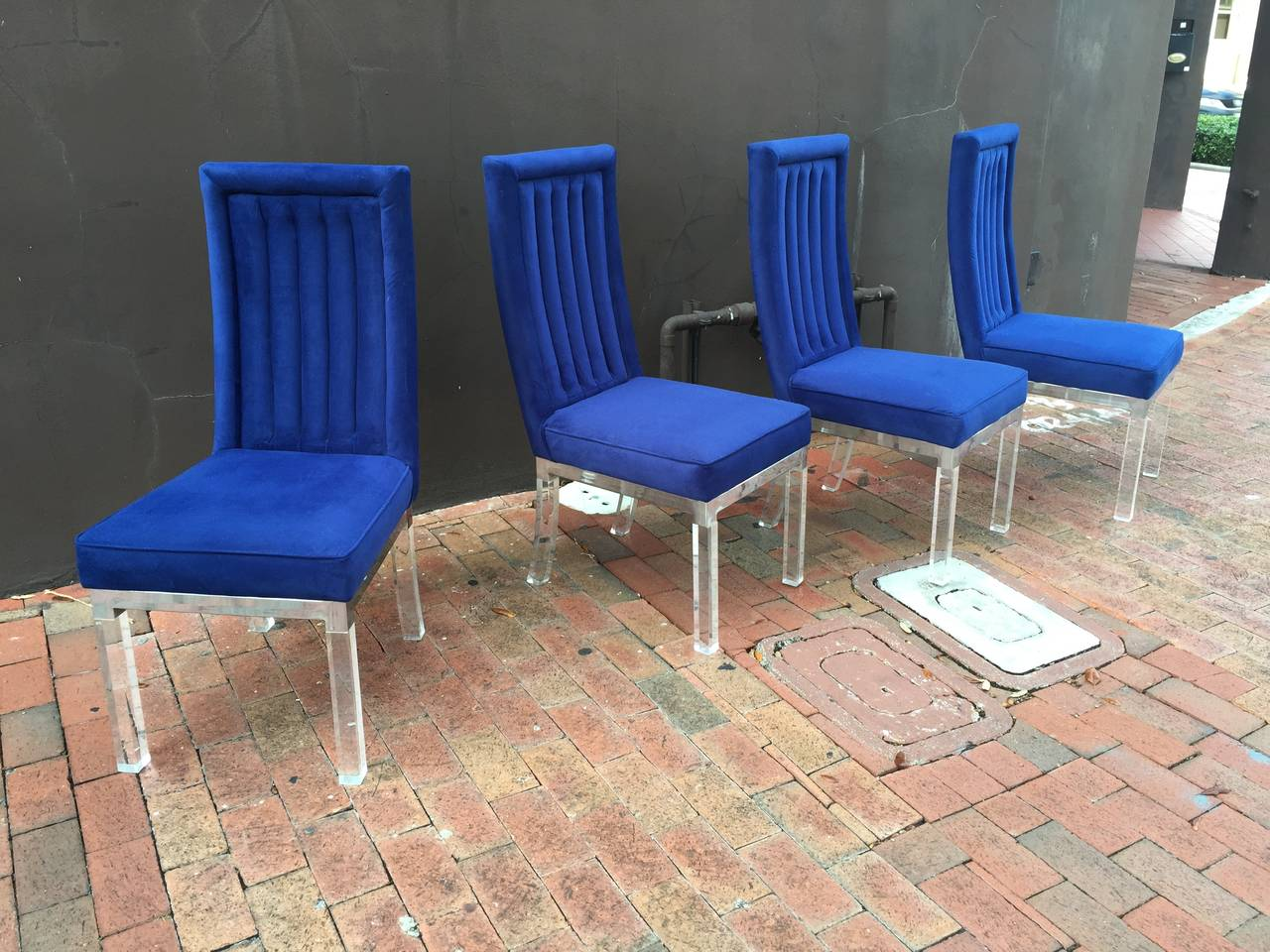 Set of six Charles Hollis Jones Dinin chairs in Lucite and nickel.  This item is currently in our Miami facility. Please call or email us directly for details.