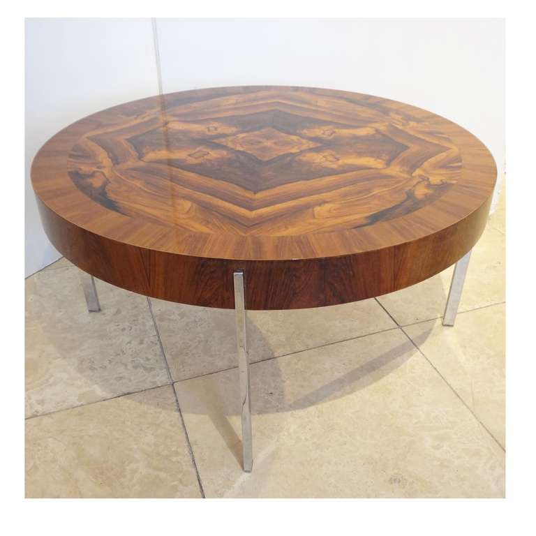 A Modernist Round Cocktail Table In Walnut And Chrome At