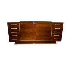 An Important Sideboard in Walnut by Renou and Genisset