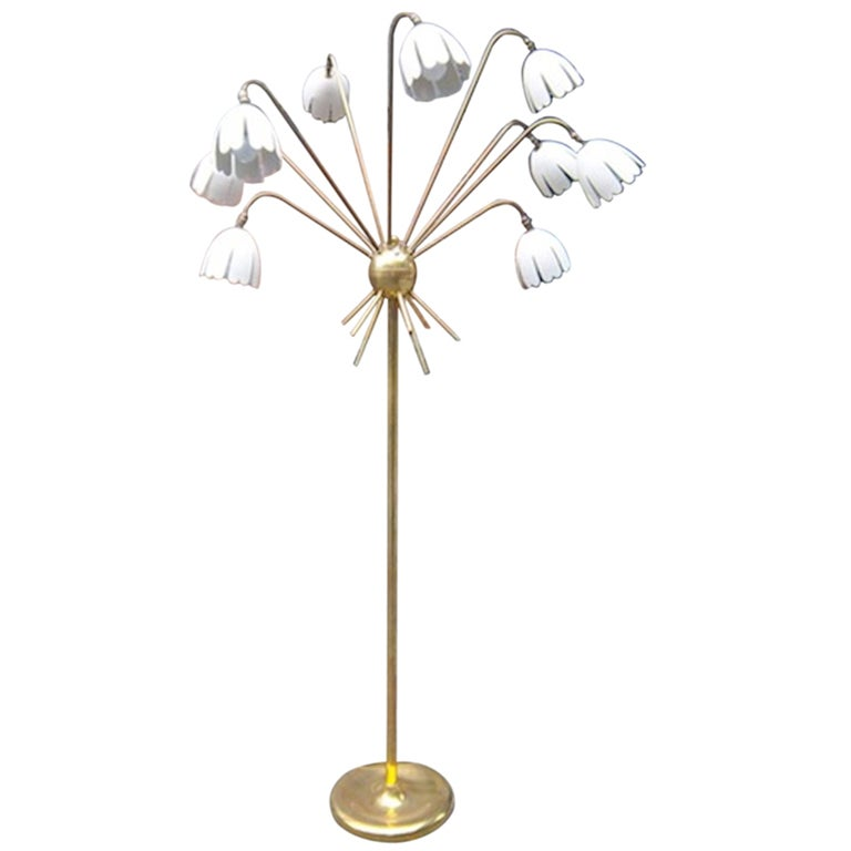 a large nine arm floor lamp in gilt brass by arredoluce at